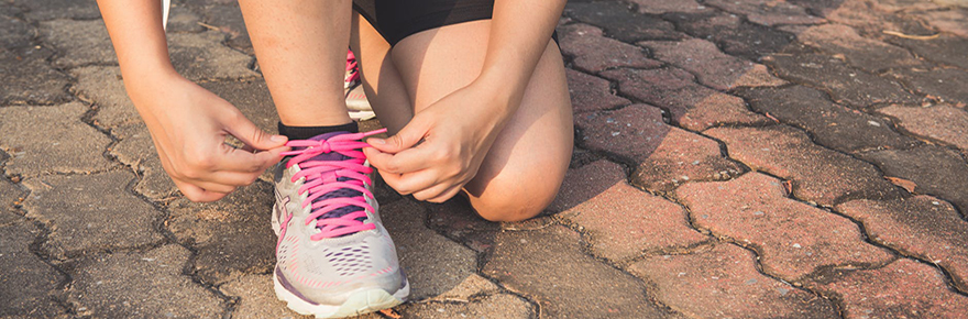 Girl tying shoe sports active woman