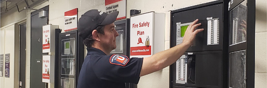 Fire safety worker checks a panel
