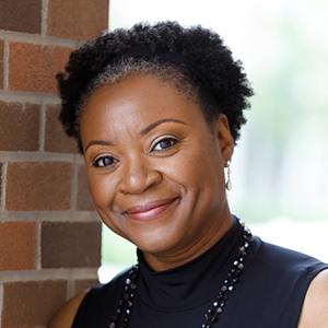 Headshot of York University Associate Professor Sarah Barrett