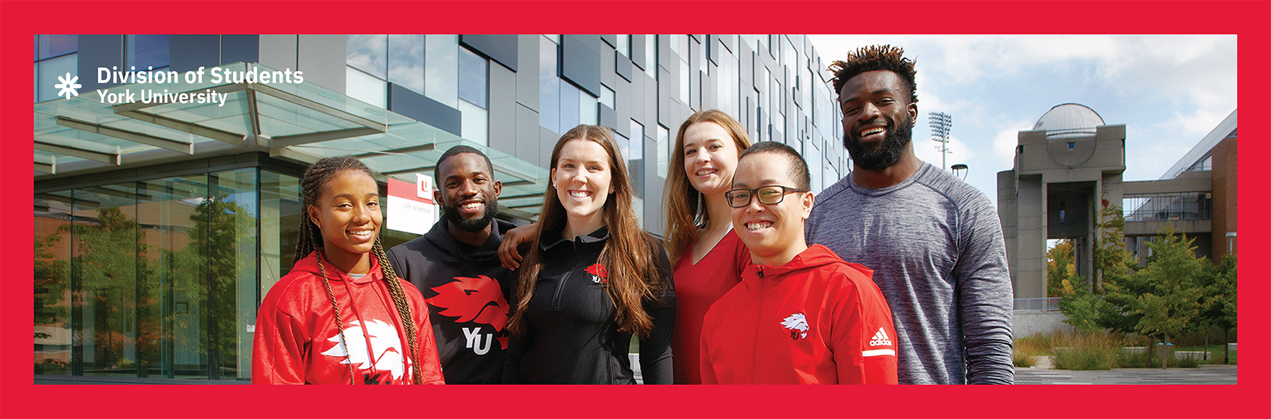 Image shows a group of students standing in front of the Life Sciences Building located on the Keele Campus