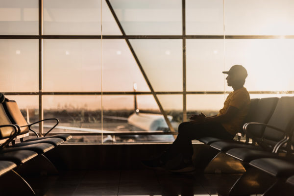 Man in airport. Photo by Marco López on Unsplash
