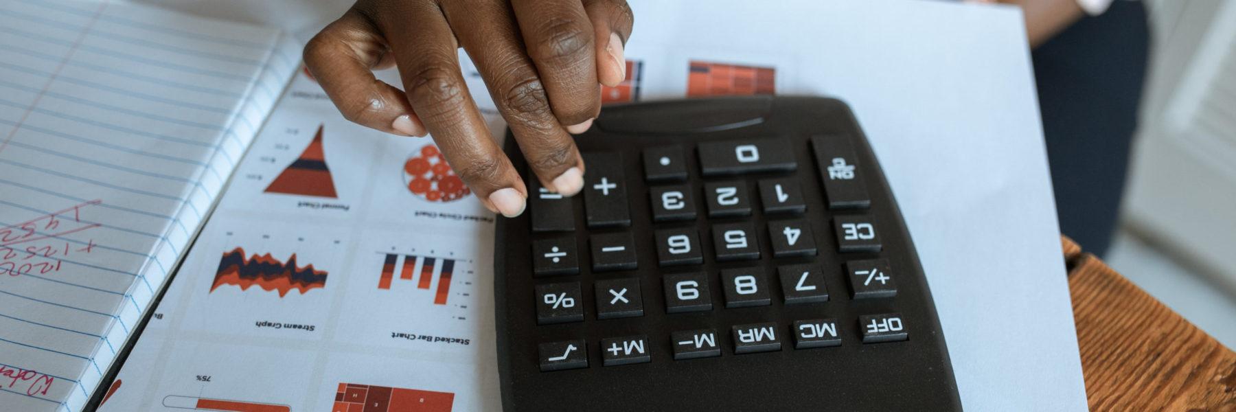 Person using black calculator